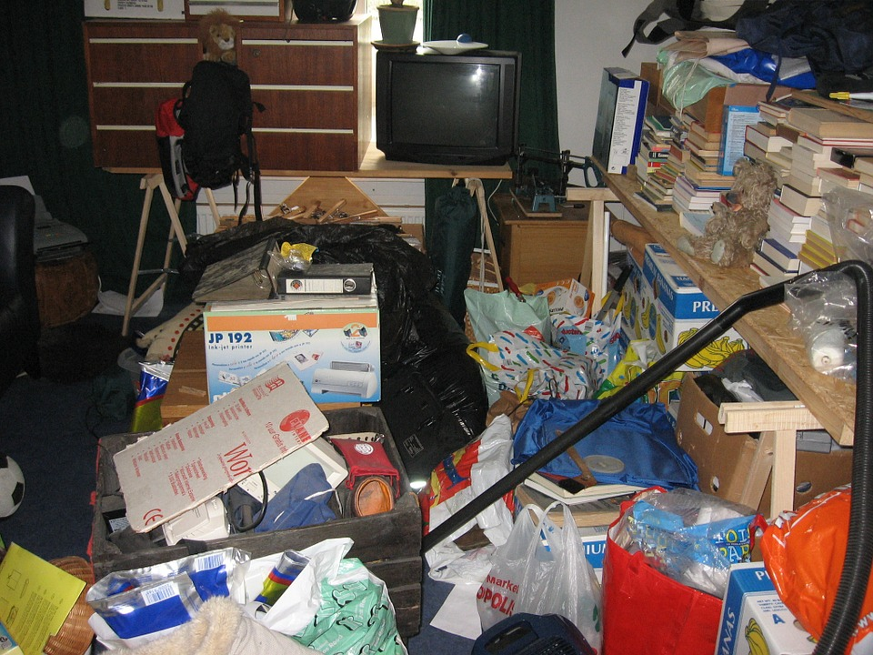 a picture of a cluttered storage unit. organizing a storage unit properly is very important.